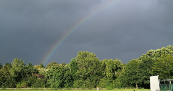 Rainbow appears during a cricket game