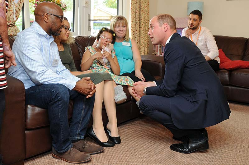 The Duke of Cambridge meeting a family at Acorns Children's Hospice in Selly Oak