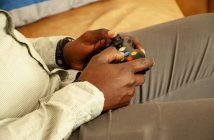 Black person playing video games