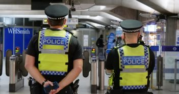 Photo of two British Transport Police on location.