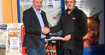 Cllr Ewan Mackey receiving the petition from Peter Harding