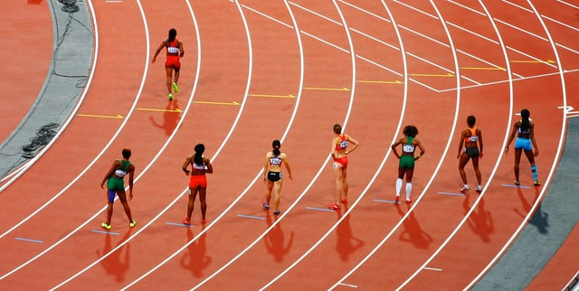 Runners on a sports track.