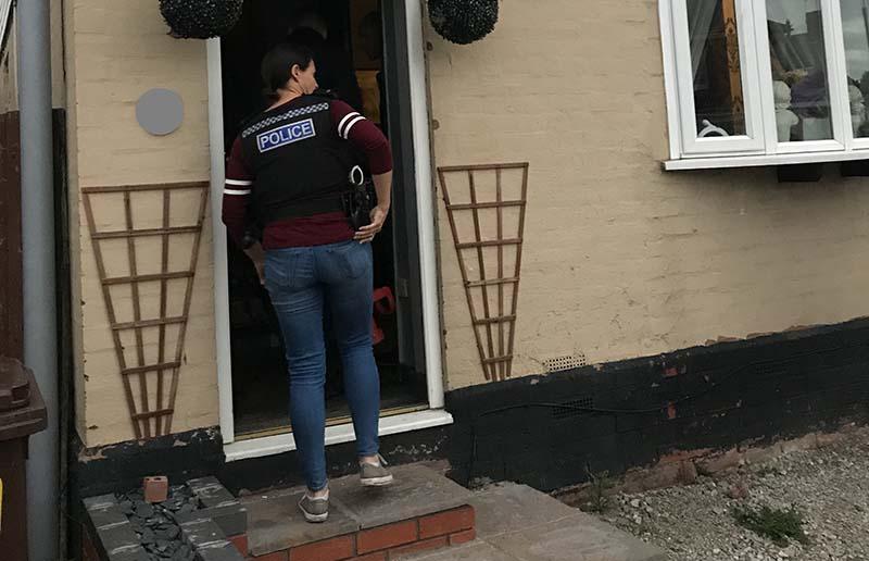 Police raiding a house in Wolverhampton