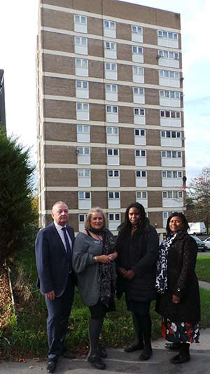 Representatives from Birmingham City Council and Croydon Council outside a tower block
